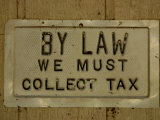 Old-Fashioned Weathered and Worn Tax Sign