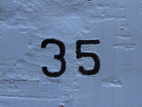 Number 35 Painted onto a White Wall