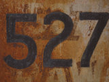 Number 527 Painted on Rusty Metal