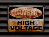 Weathered and Rusted Metal High Voltage Danger Sign