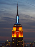 Top of the Empire State Building Illuminated at Night in New York City  New York