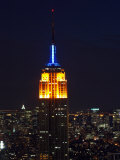 Top of the Empire State Building Illuminated at Night Above New York City  New York