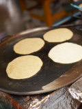 Traditional Tortillas Cooking on Griddle