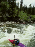 Kayaker Paddles to Get Through the Rapids  Middle Fork Of The Salmon River  Idaho