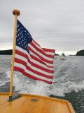 Flag Waves on the Stern of a Maine Made Hampton Yacht  Kennebec River  Bath  Maine  USA