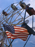 Flag in Front of a Ferris Wheel Against a Summer Sky  New London  Connecticut  USA