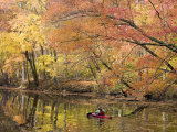 Woman Kayaking Down the Chesapeake and Ohio Canal National Park