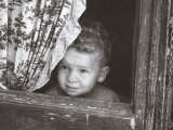 Boy Watches from the Window