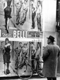Man Looking at the Poster of the Film by the Film-Director Dino Risi  Poveri Ma Belli