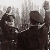 Benito Mussolini Honors a Fascist Official with a Salute