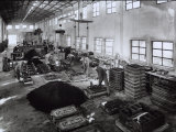 Inside of a Ferrari Factory with Some Workers