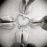 Four Pairs of Feet Standing around a Heart Shape Drawn in Sandy Beach  Taransay  Scotand  UK