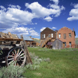 Old Farm Wagon and Derelict Wooden and Brick Houses at Bodie Ghost Town  California  USA