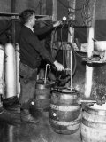 'Brewmeister' Fills Kegs at a Bootleg Brewery During Prohibition  1933