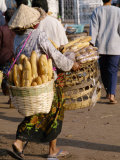Woman Carrying Baskets of French Bread  Talaat Sao Market in Vientiane  Laos  Southeast Asia