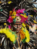 Man with Facial Decoration and Head-Dress with Feathers at Mardi Gras Carnival  Philippines