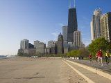 Joggers and Cyclists on Lake Michigan Shore  Oak Street Beach  Chicago  Illinois  USA