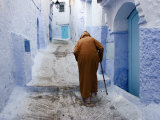 Old Man Walking in a Typical Street in Chefchaouen  Rif Mountains Region  Morocco