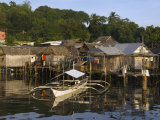 Stilt Houses and Catamaran Fishing Boat  Coron Town  Busuanga Island  Palawan Province  Philippines