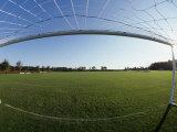 View of Soccer Field Through Goal