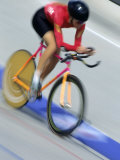 Blured Action of Female Cyclist Competing on the Velodrome