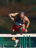 Mature Athlete Competing in Hurdles Race  Atlanta  Georgia  USA
