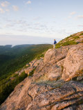 Lone hiker near the summit of Cadillac Mountain  Acadia National Park  Maine  USA