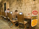 Men working at outdoor internet café  Dubrovnik  Dalmatia  Croatia