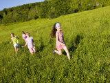 Young girls running in field  Sabins Pasture  Montpelier  Vermont  USA