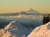 Snow-covered view of Mt Jefferson and Three Sisters Mountains  Oregon  USA