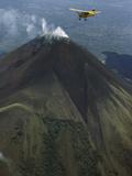 Plane Flies over a Smoking Volcano Called Momotombo