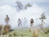 Photo of Soldiers with Gas Masks and Bayonets in Combat Training