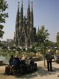 People Relaxing in View of the La Sagrada Familia Church  by Gaudi