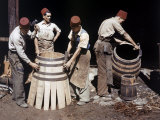 Malaysian Coopers Work Making Barrels at a Winery