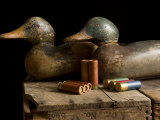 Antique Duck Decoys and Shotgun Shells Sit on an Old Wooden Crate