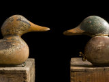 Antique Duck Decoys Sit on an Old Wooden Crate