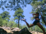 Woman Trail Running in Mountains