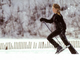 Woman Runs with Snowshoes