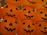 Colorful Plastic Jack-O-Lanterns Grin at the Approach of Halloween