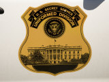 Insignia of the US Secret Service on Car Door Shows the White House