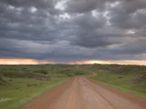 Muddy Road Disappears into the Thunderclouds