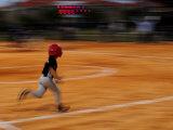 Boy Runs During a Baseball Game at Night