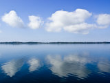 Fluffy Clouds Float over a Perfectly Still Lake on a Hot Summers Day