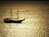 Silhouette of a Double Masted Sailboat on the Water