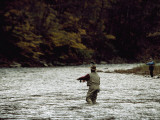 Two Men Fly-Fishing in a Swift Moving River