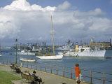 People at Gosport Hard Park Watch Ship Traffic at Naval Dockyards