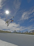 Skiing Aerial Maneuvers and Flips in Half Pipe in a Terrain Park