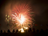 Group of People Watch Fireworks Light Up the Sky at a Fiesta