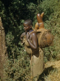 Woman Carries Gourds Filled with Water