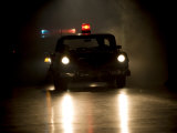 Antique Police Car on Night Patrol